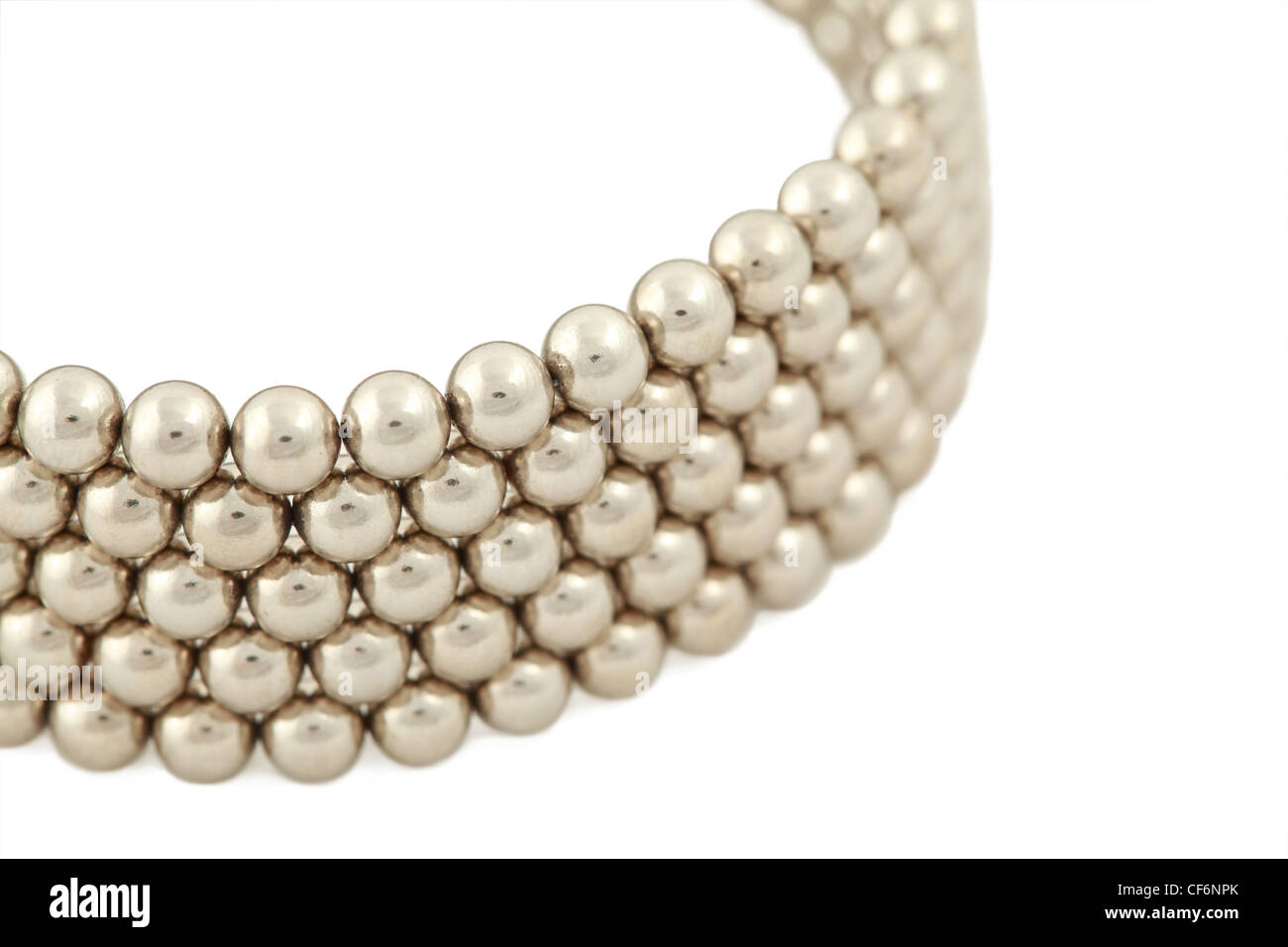 Part of bangle from beads near-by on  white background - Stock Image