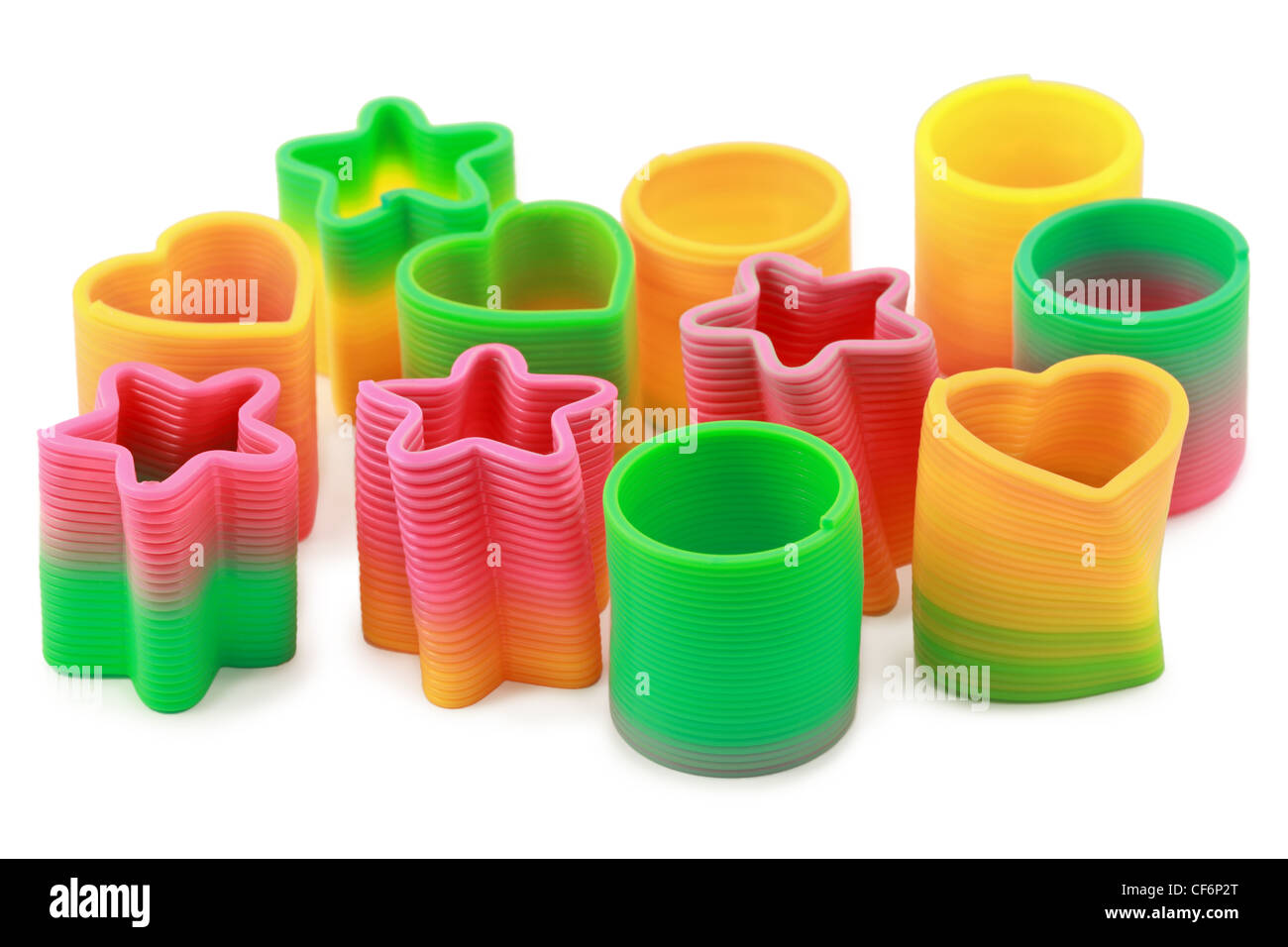 Varicoloured springs of different form lie on  white background - Stock Image
