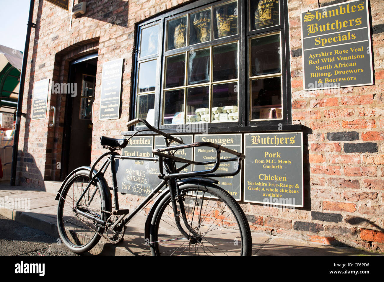 York City, Yorkshire, England shambles butchers in the iconic Shambles with traditional butcher bike outside - Stock Image