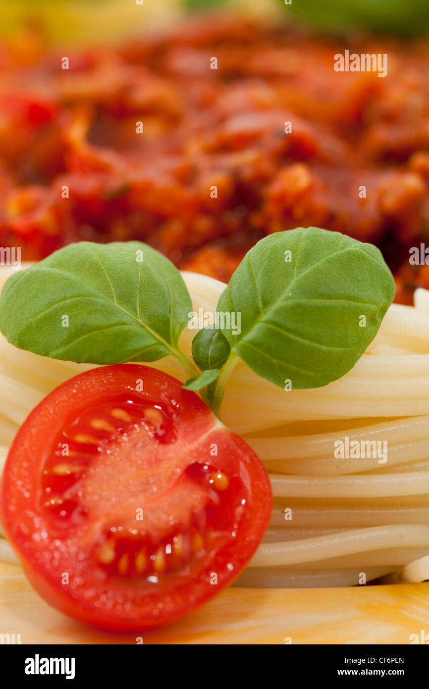 Pasta with tomato sauce and fresh basil - Stock Image