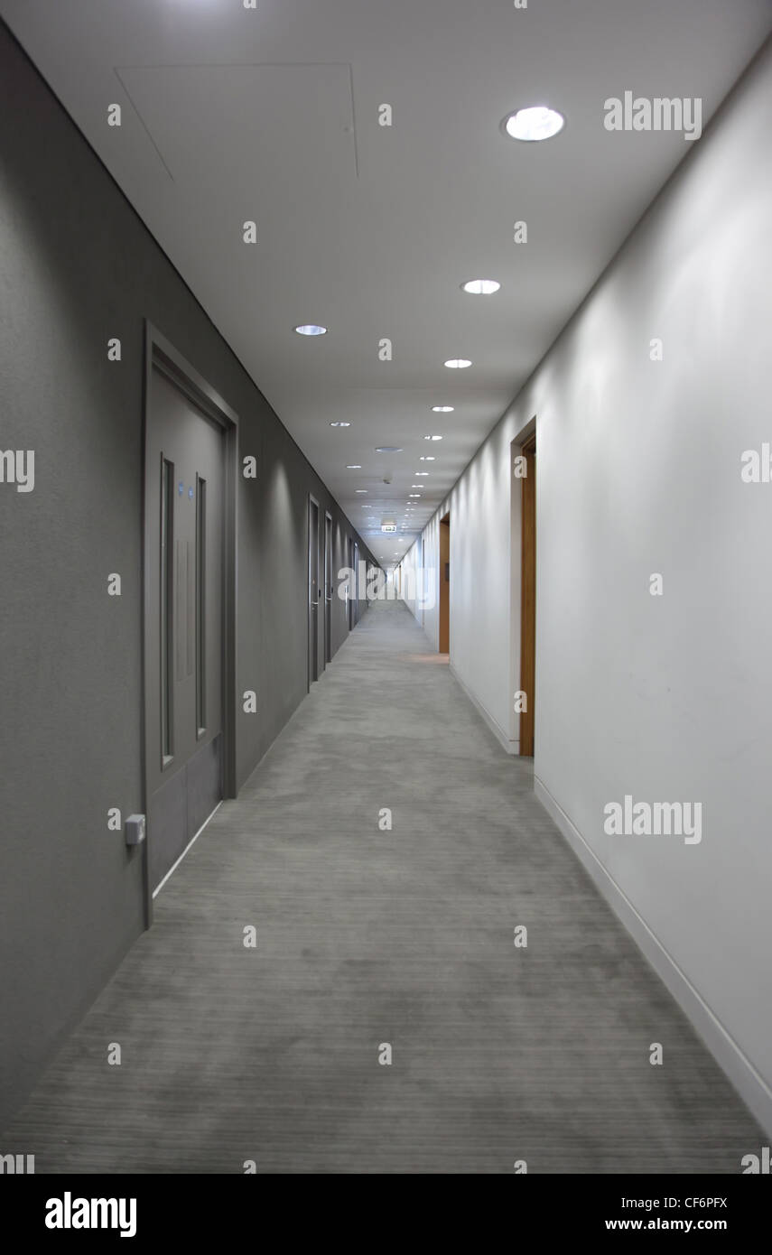 a long gray hallway with doors. light at the end of the corridor - Stock & Long Hallway Doors Stock Photos u0026 Long Hallway Doors Stock Images ...