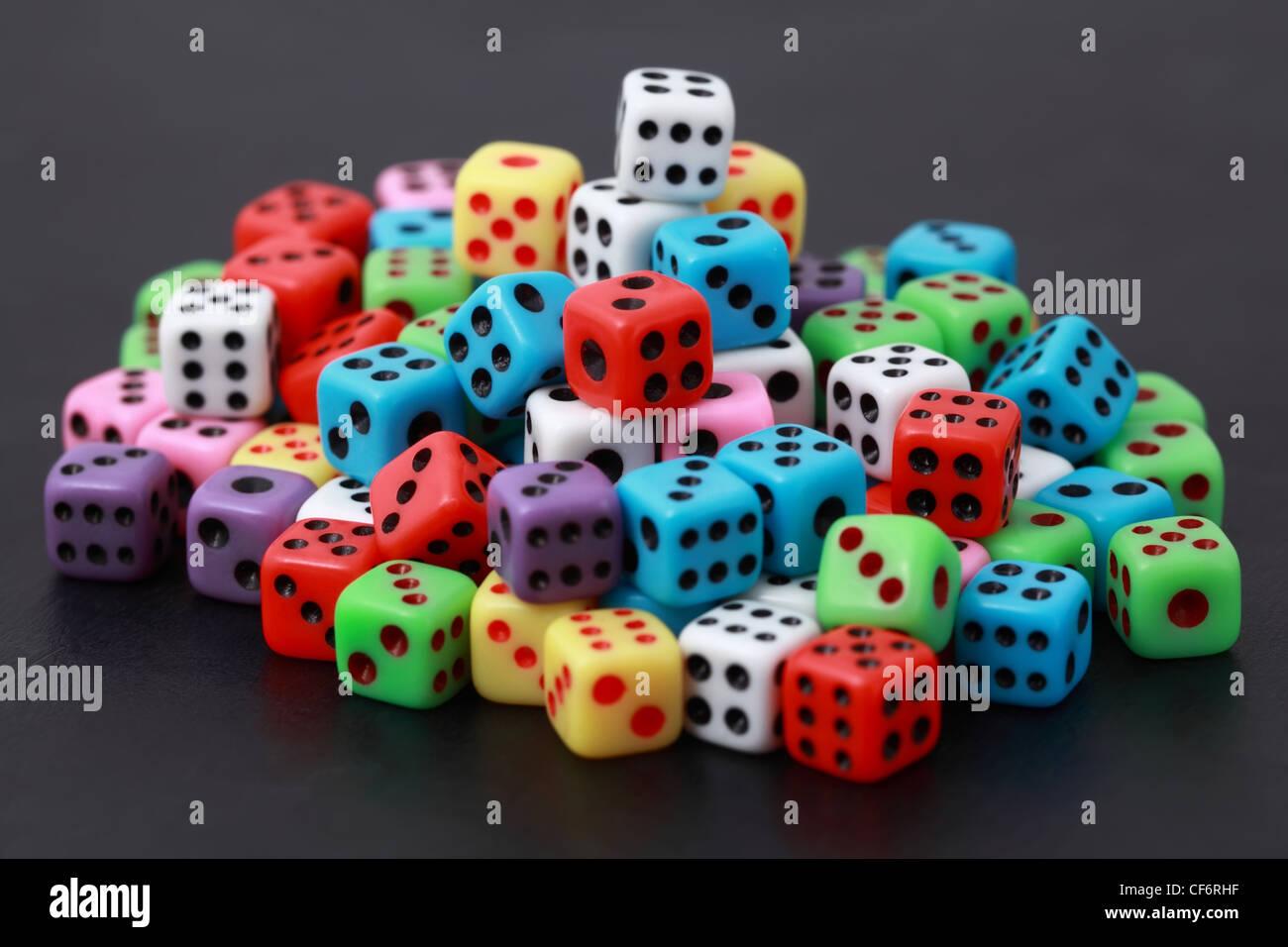 Playing varicoloured bones lie on  heap - Stock Image