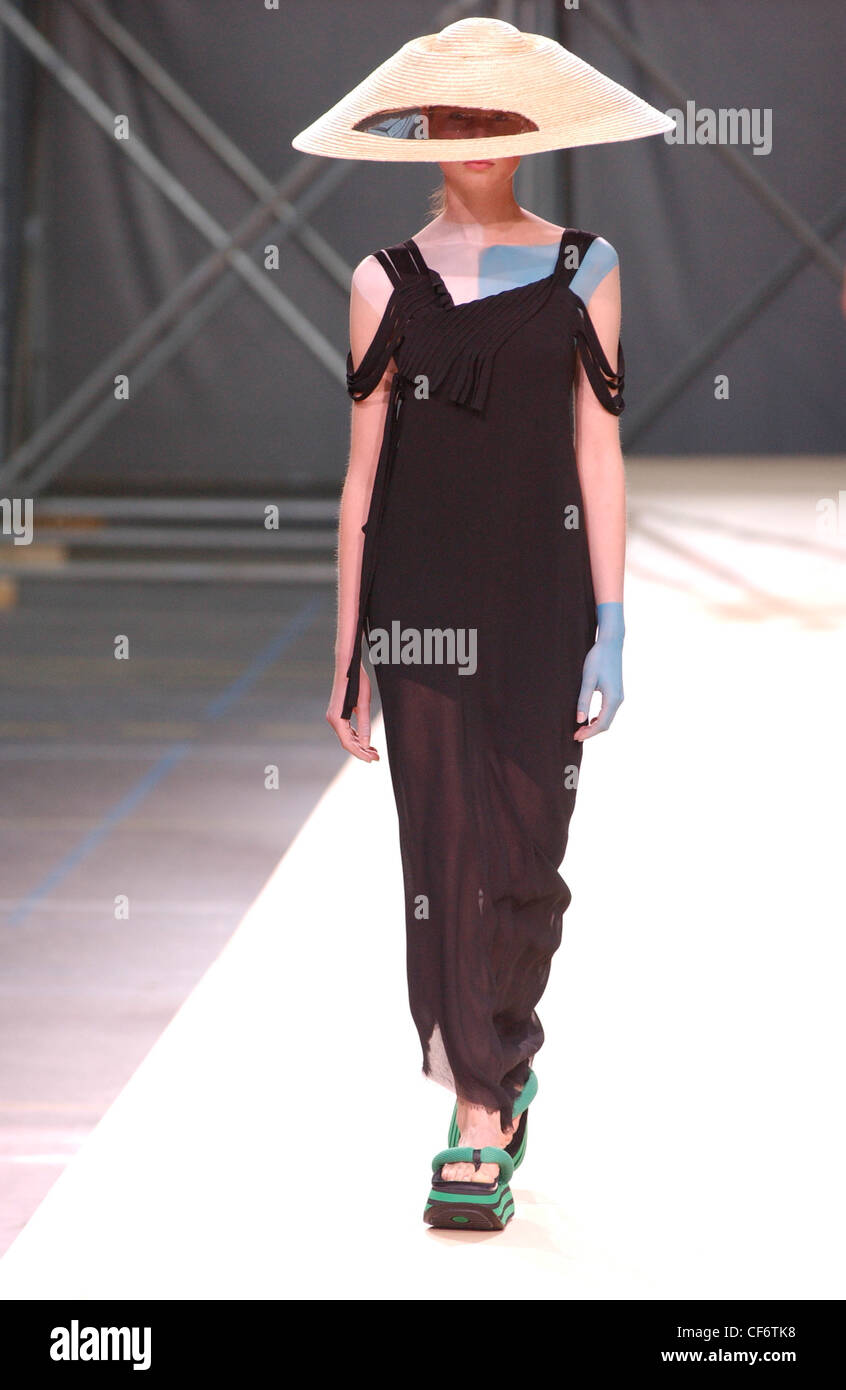 45c2fd9296f Yohji Yamamoto Haute Couture Paris autumn winter fashion show Model wearing  large straw hat cut out