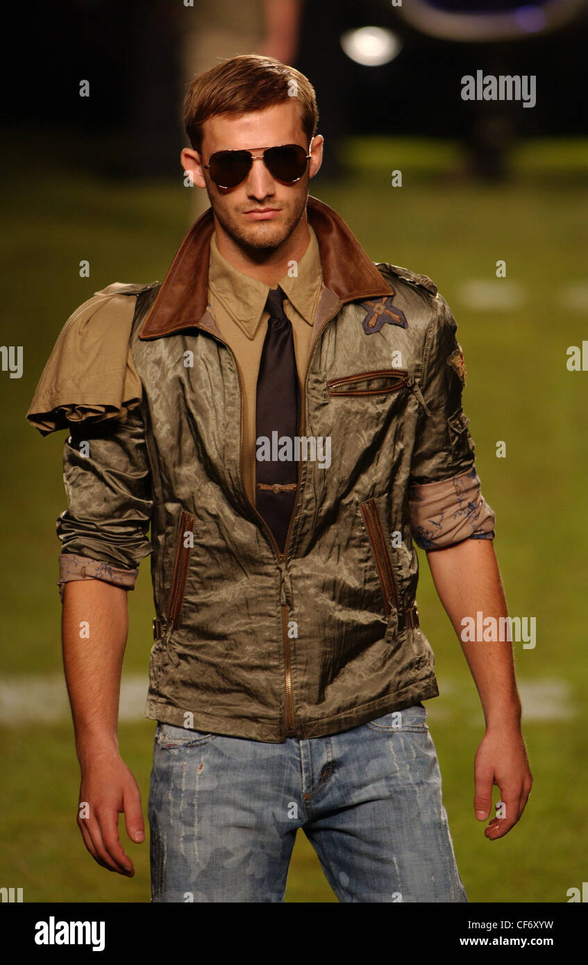 Iceberg Milan Menswear S S Male wearing aviatshades, olive coloured aviatjacket shoulder epaulets and rolled up Stock Photo