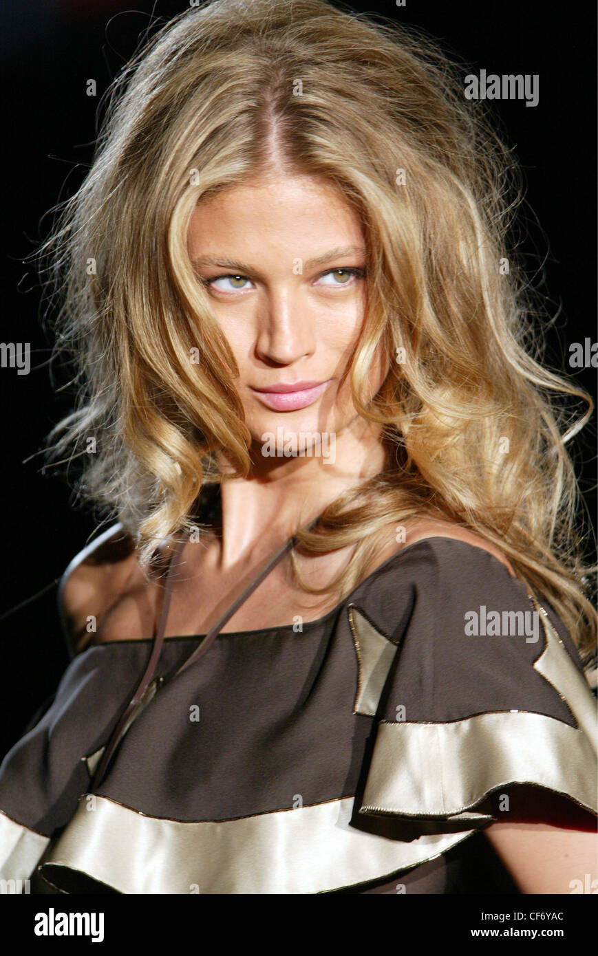DSquared Milan Ready to Wear S S Blonde female big tousled hair wearing satin brown frilly outfit, accessorised - Stock Image