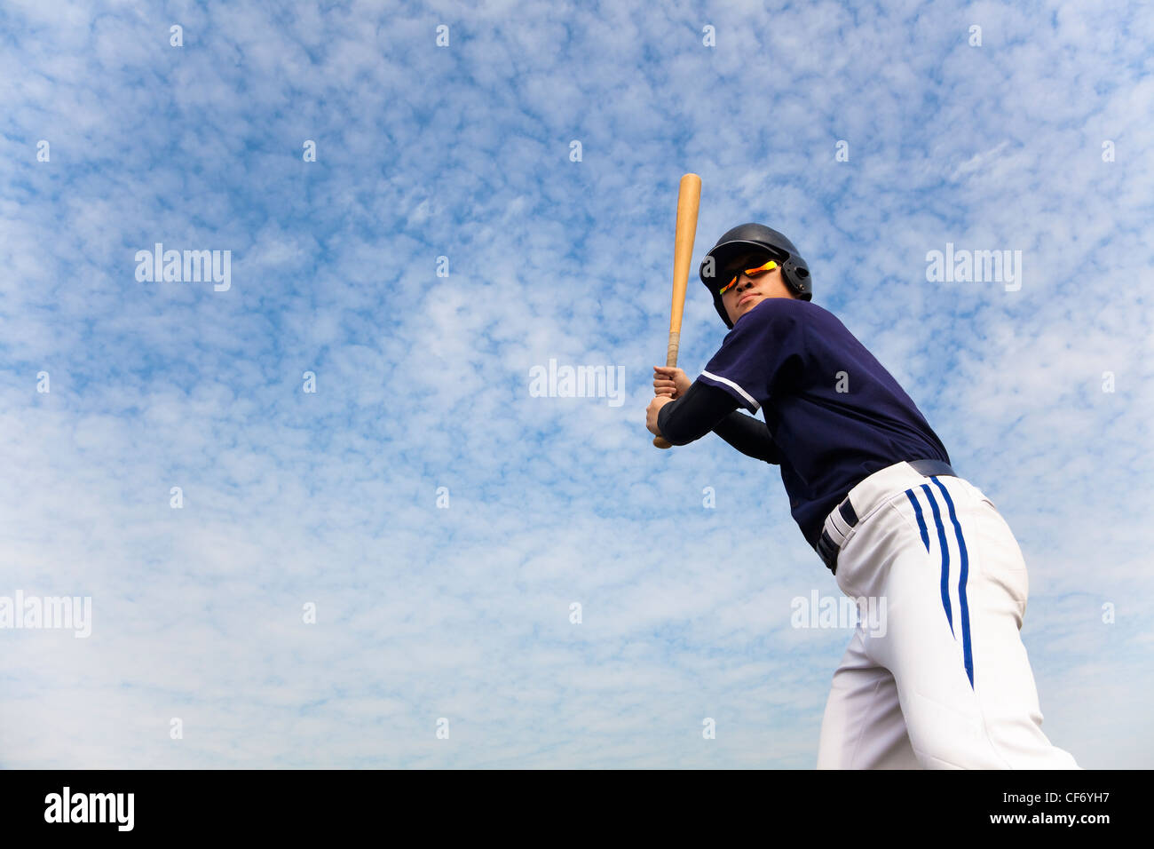 young baseball player ready for swing - Stock Image
