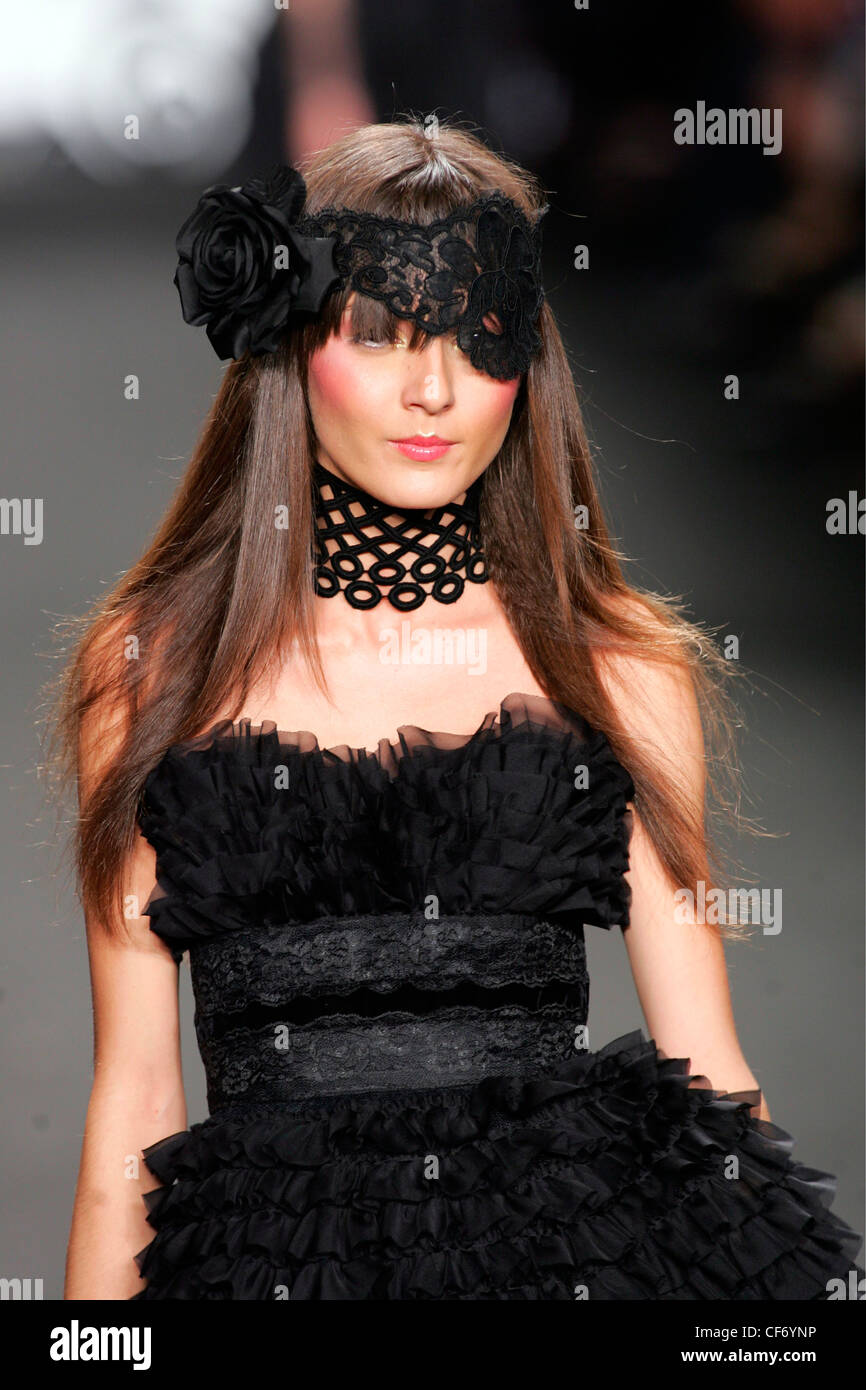 02c08987d16 Anna Sui New York Ready to Wear Spring Summer Model Irina Lazareanu wearing  a black ruffled strapless dress a lace waistband