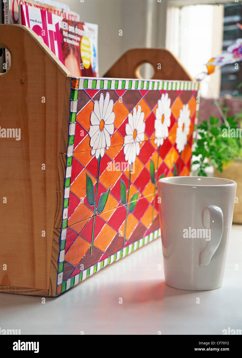 Glass glaze creations Turn ordinary articles into works of art colourful glass glaze Wooden magazine holder decorated - Stock Image