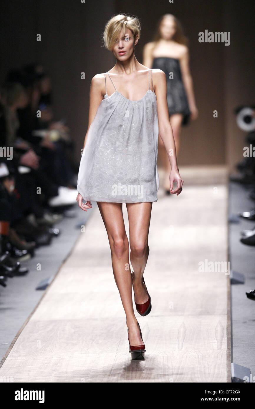 aeb7b69c4f9b3 Stella McCartney Paris Ready to Wear Autumn Winter Model wearing a light  grey babydoll style mini