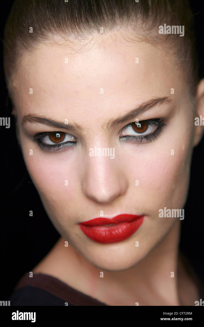 Model With Metallic Silver Eyeshadow Black Eyeliner And Bright Red