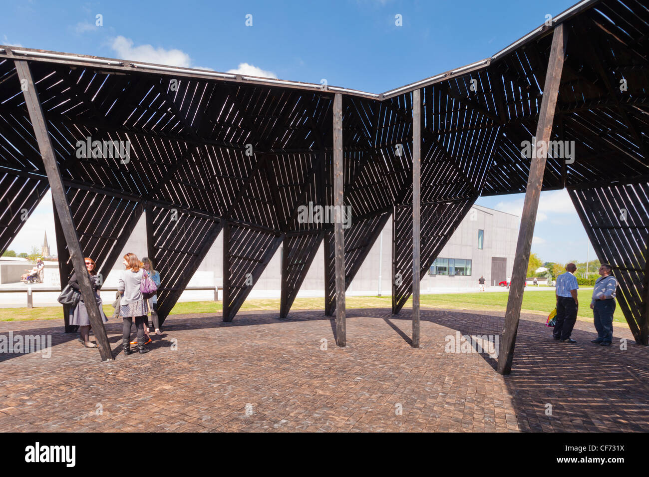 People enjoying an outdoor piece of art, The Black Cloud by Heather and Ivan Morison, at the Hepworth Wakefield, - Stock Image
