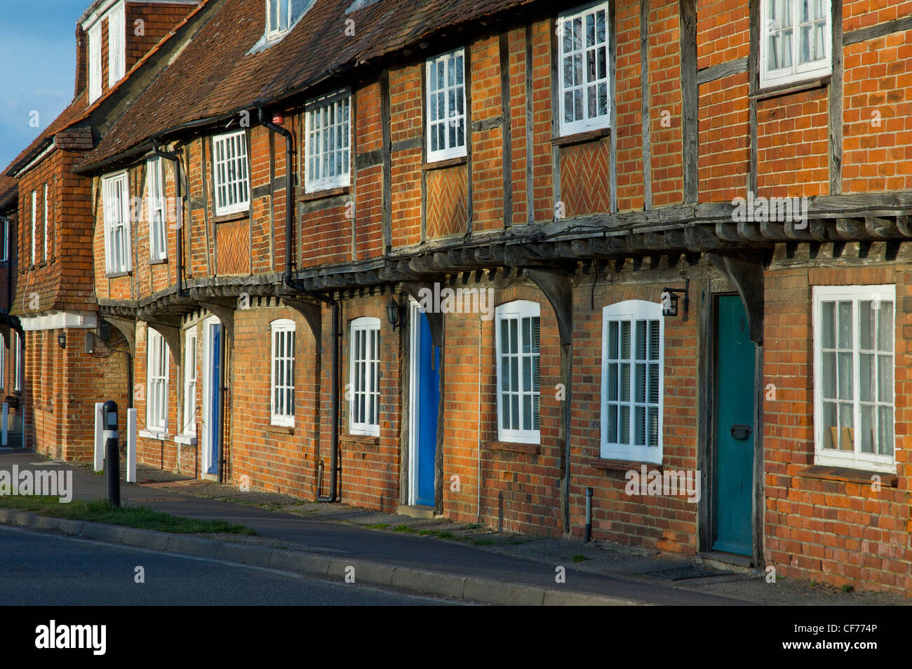 Terrace of brick-built houses in the village of North Warnborough, Hampshire, England UK Stock Photo