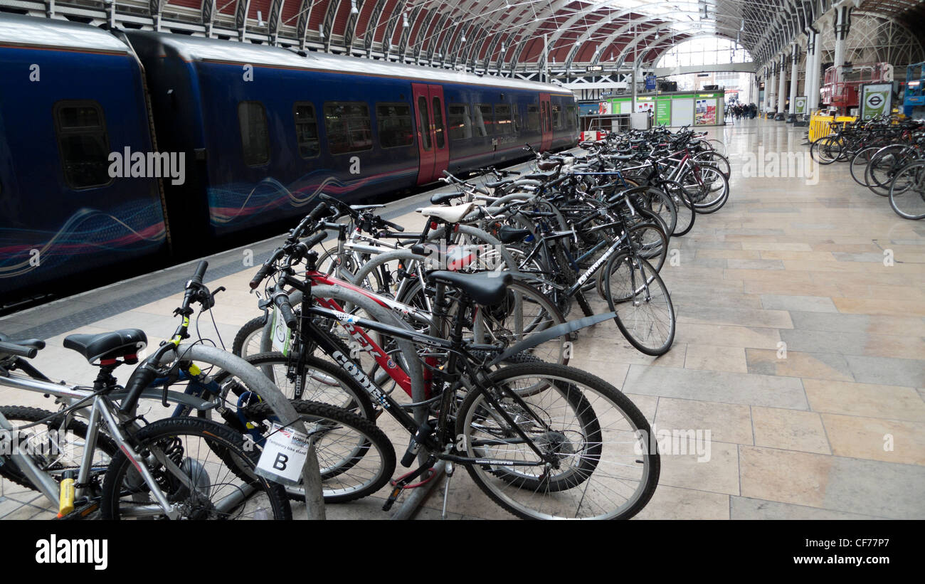 Bikes stored on a temporary bicycle stand on the train platform at Paddington Station London England UK - Stock Image