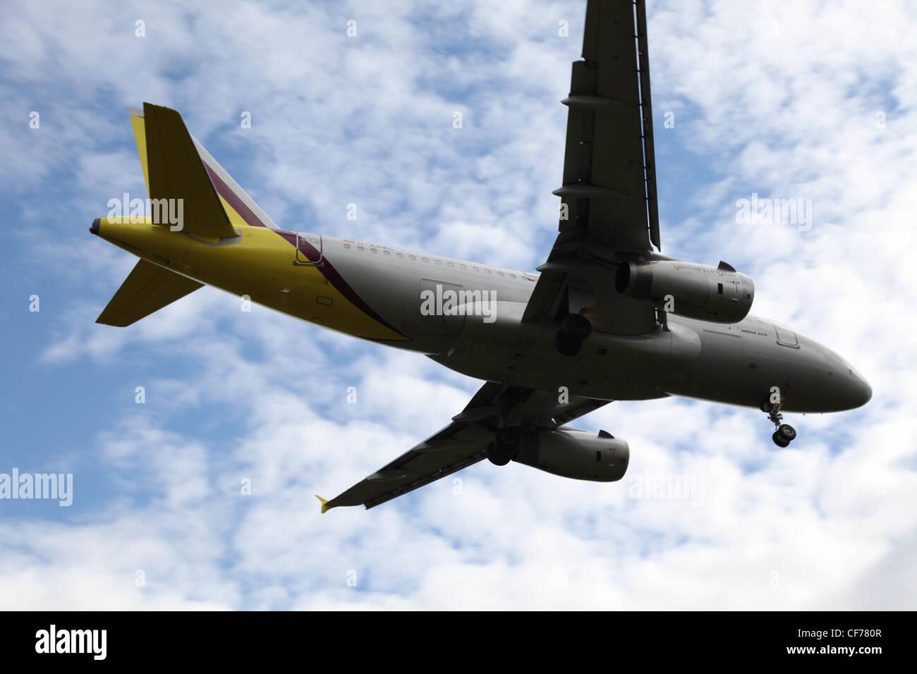 Plane in a cloudy sky, Flugzeug am bewölkten Himmel - Stock Image