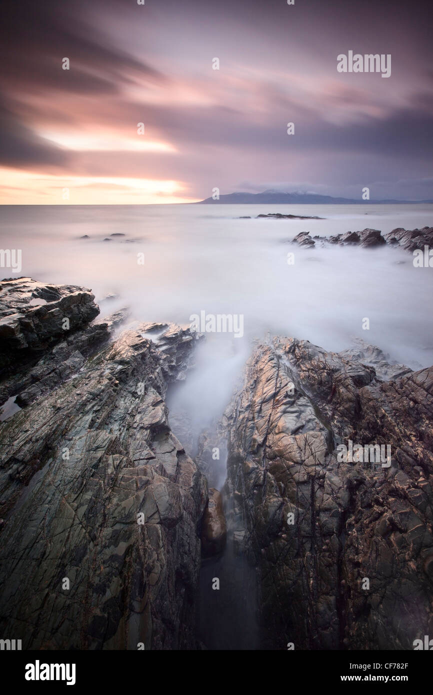 View of the Mounre Mountains from County Down coast. - Stock Image