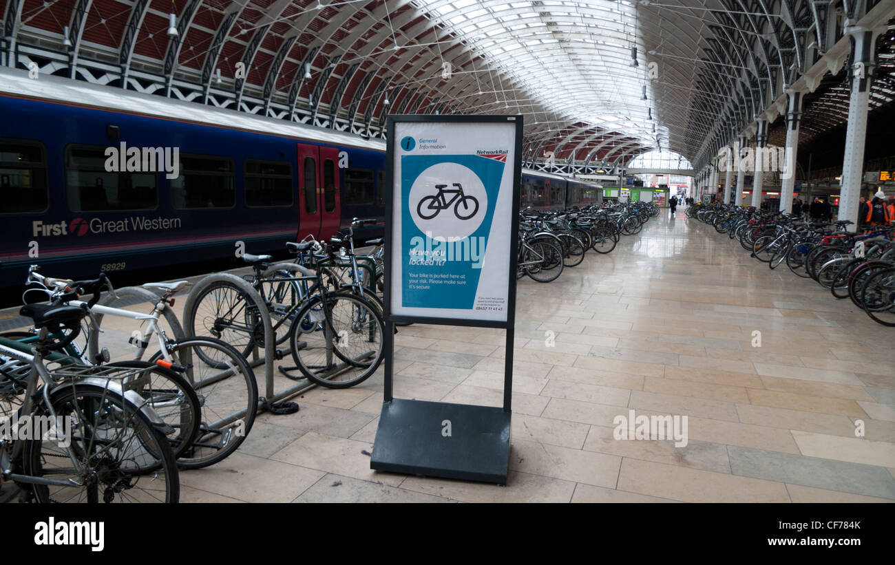 Network Rail Information panel next to bike storage cycling racks on the train platform at Paddington Station London England UK & Network Rail Information panel next to bike storage cycling racks on ...