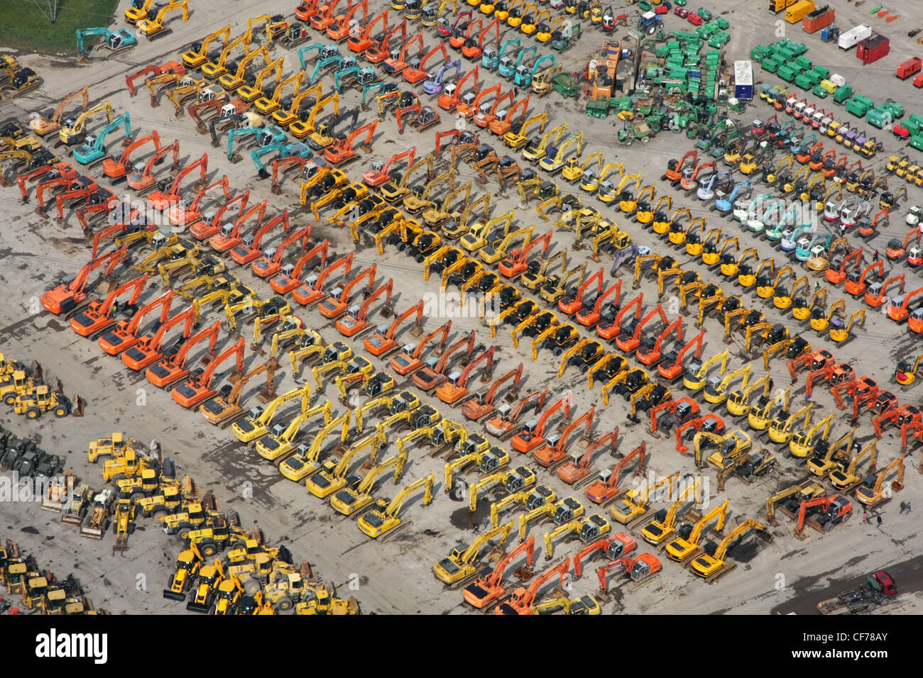 Aerial view of JCB diggers lined up for an auction sale - Stock Image
