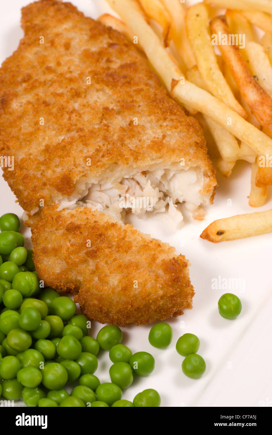 Traditional fish and chips served with peas - Stock Image