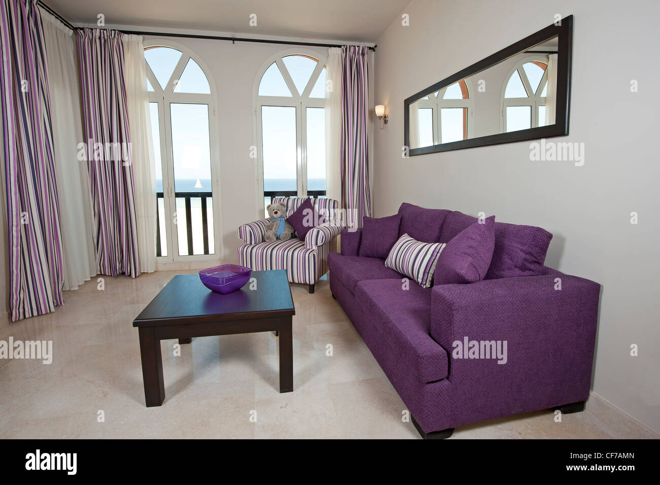 Interior design of a luxury apartment living room with a sea view - Stock Image