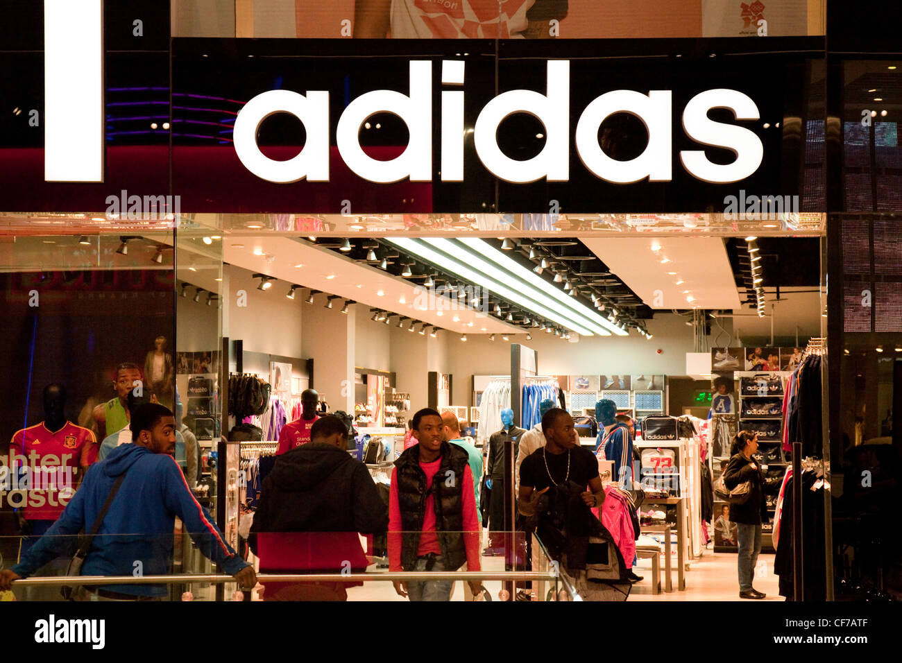 People standing outside the Adidas store, Westfield shopping centre Stratford London UK - Stock Image