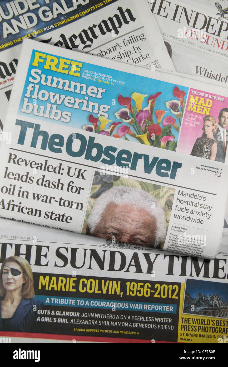 The Observer sitting on the other quality UK national newspapers (The Sunday Times, The Sunday Telegraph, The Independent). - Stock Image