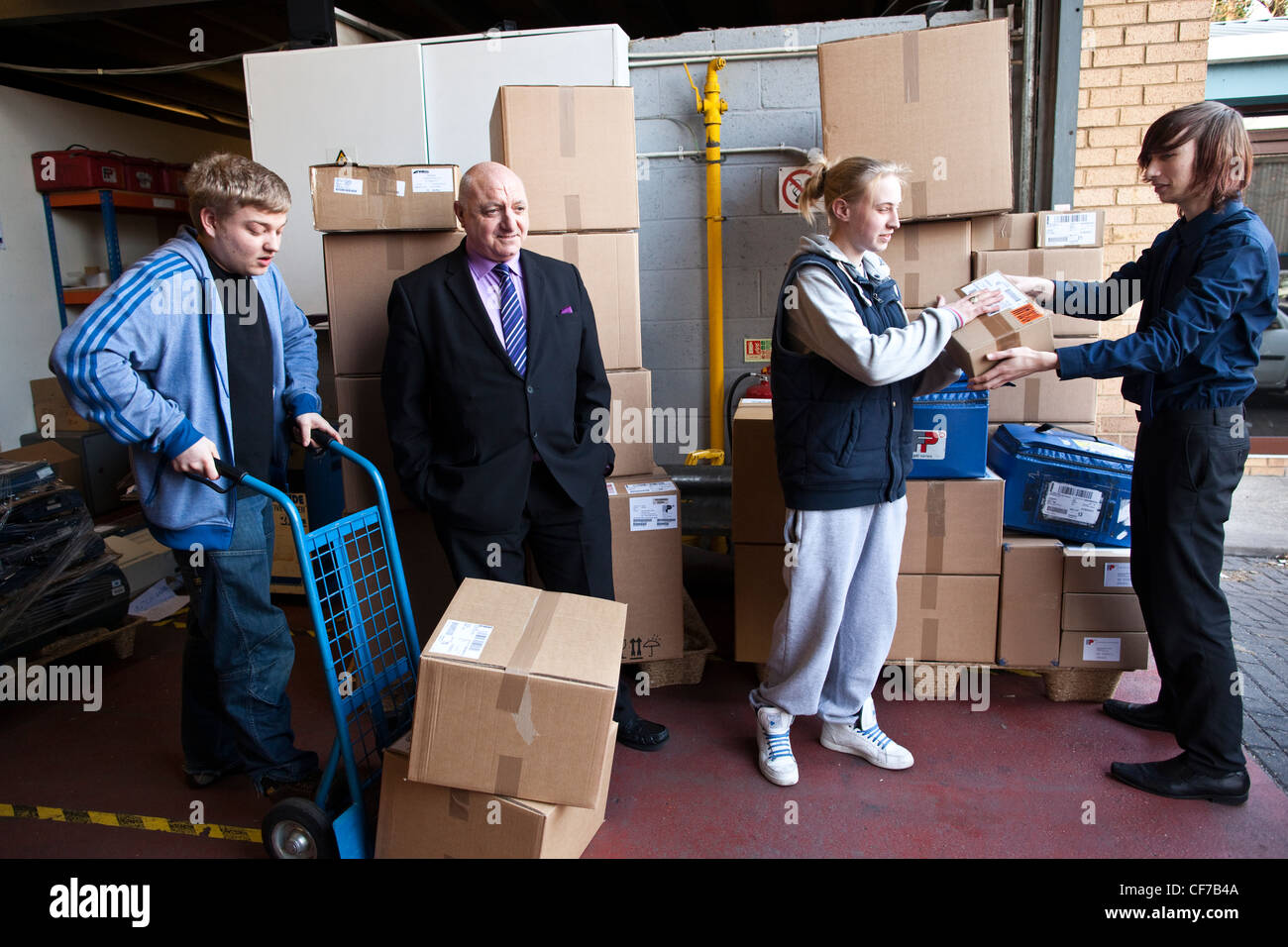 18 -24 year olds on 'Workfare' programme UK Government work experience scheme to give young jobseekers work - Stock Image