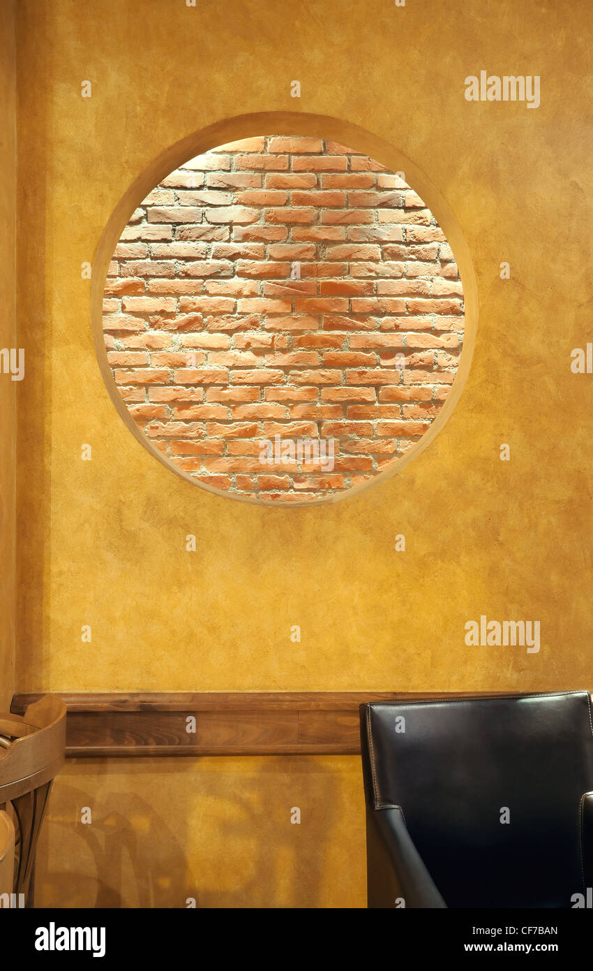 Interior of a cafe, details of wall design, big round hole in the ...