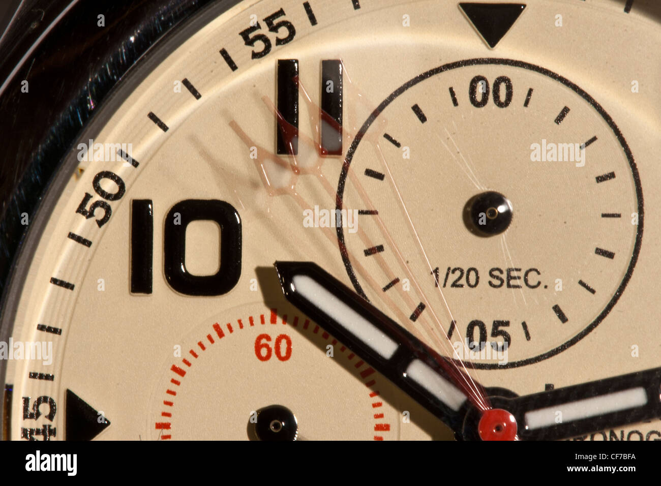 A close-up photo of a watch face over a three second exposure. - Stock Image