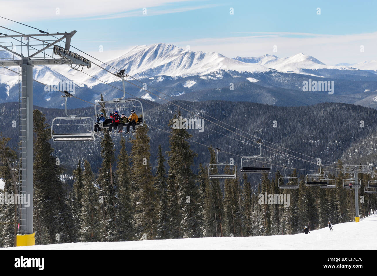 Chairlift bringing skiers to the summit, Keystone Resort, Colorado - Stock Image