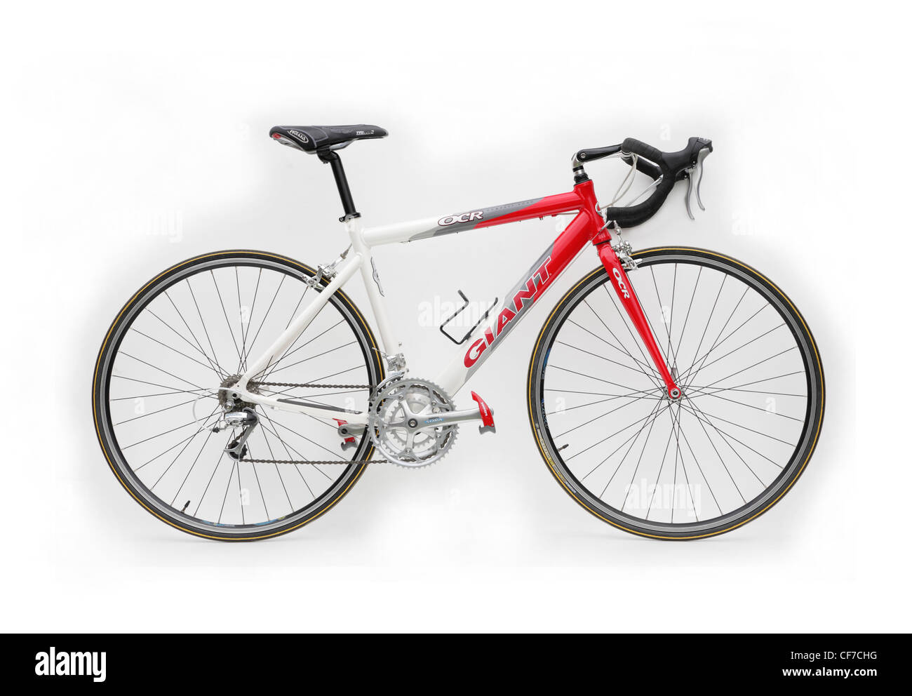 cutout of a Giant brand racing bike cycle with clipless look pedals isolated on against white background - Stock Image
