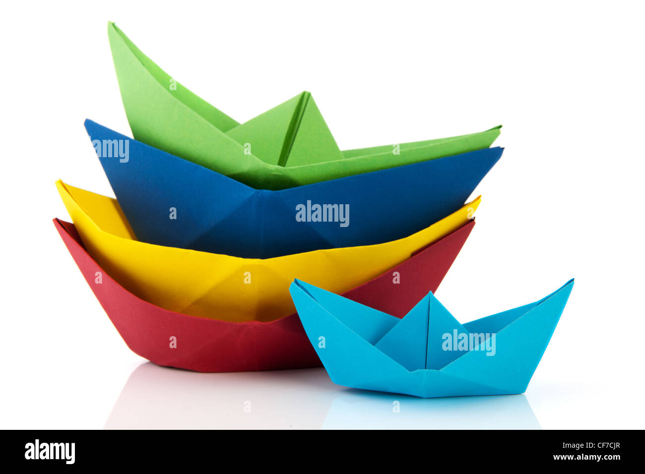 Stacked Colorful Folded Paper Boats Isolated Over White Background