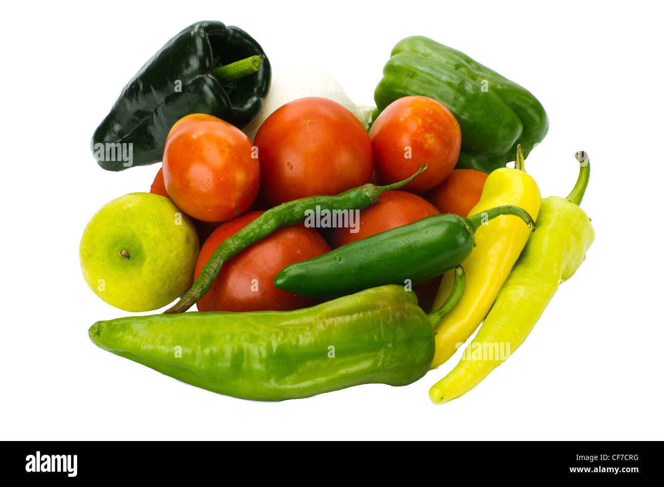 Fresh ingredients for salsa peppers tomatoes onion lime - Stock Image