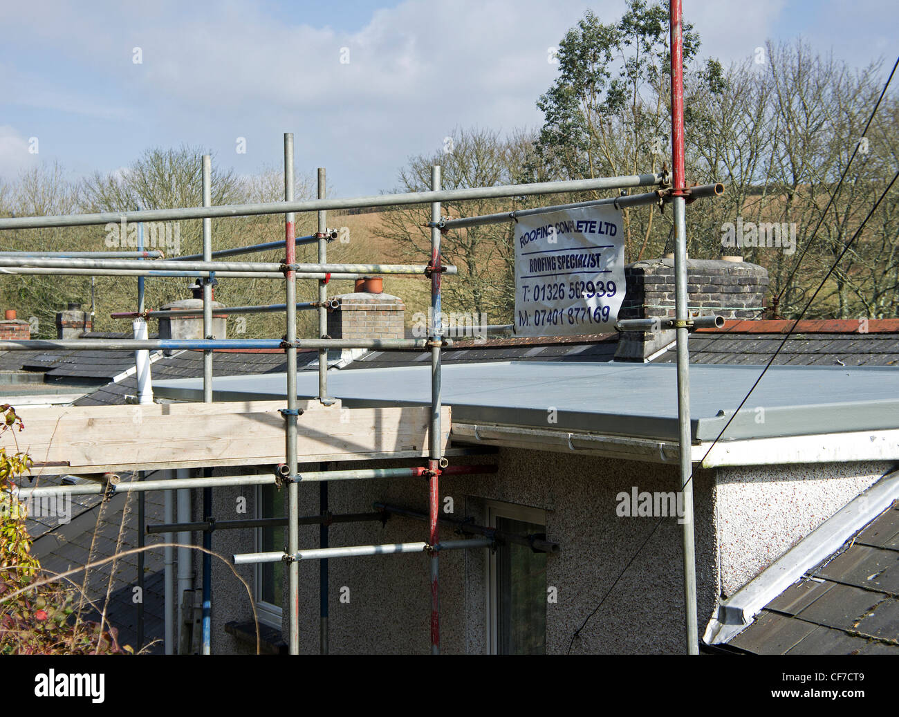 Scaffolding on a house that has had some repairs done to the roof, uk Stock Photo