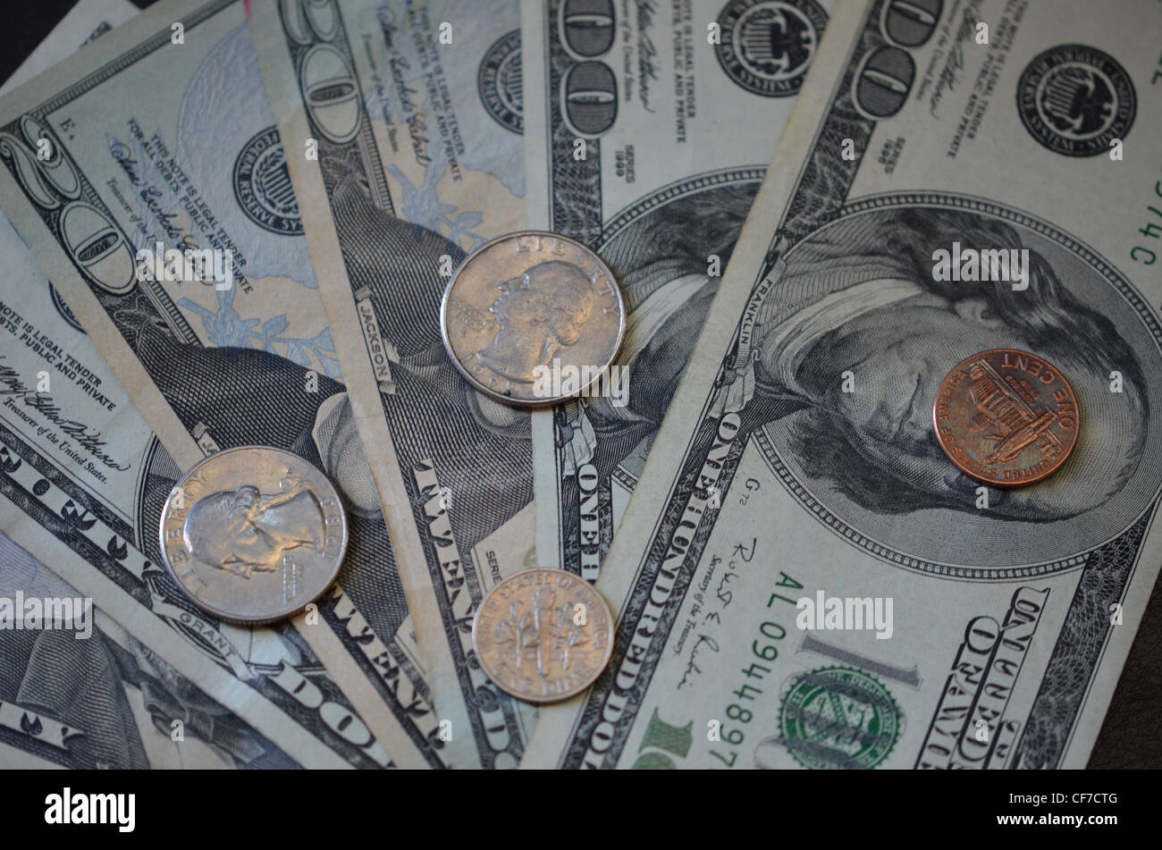 large bills US currency and change - Stock Image