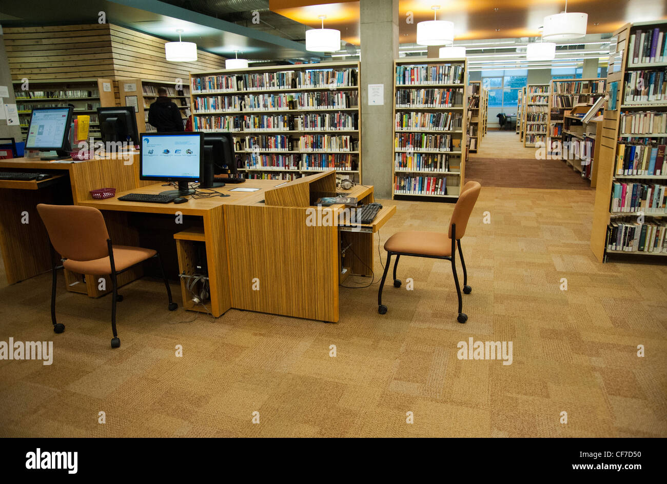 Interior of library with computer stations - Stock Image