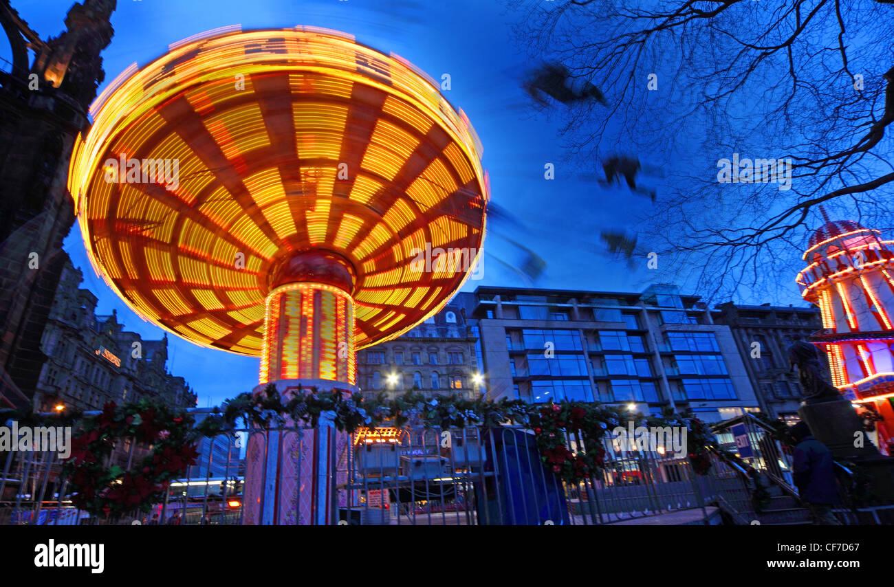 Edinburgh Merry Go around in Princess Street Gardens, winter fair, Lothians, Scotland, UK  @HotpixUK - Stock Image