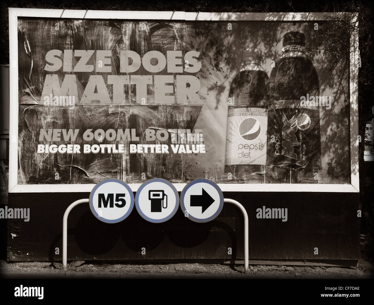Size does matter poster at M5 Frankly services petrol fuel area Stock Photo