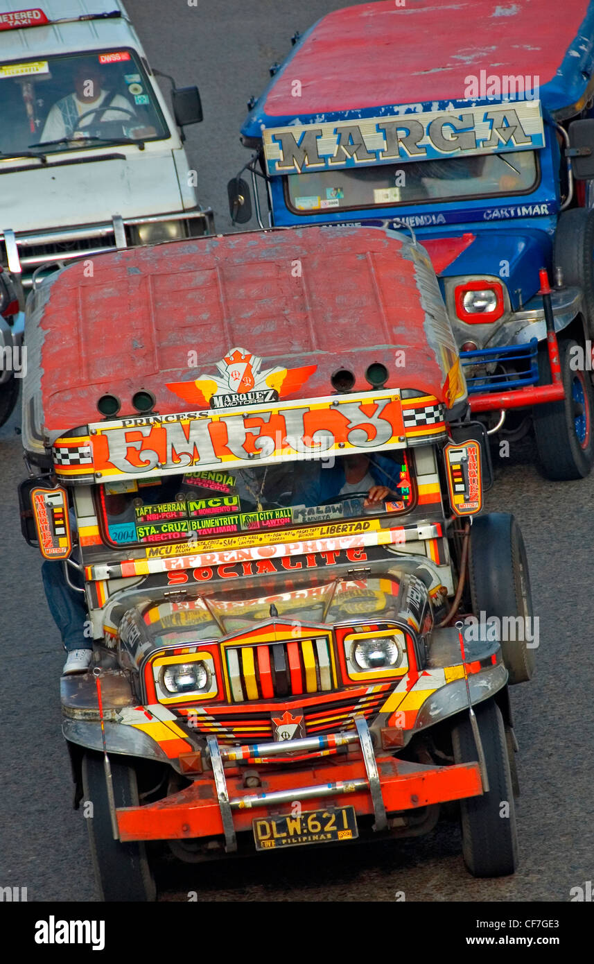 Jeepney public buses, central Manila, Philippines. - Stock Image
