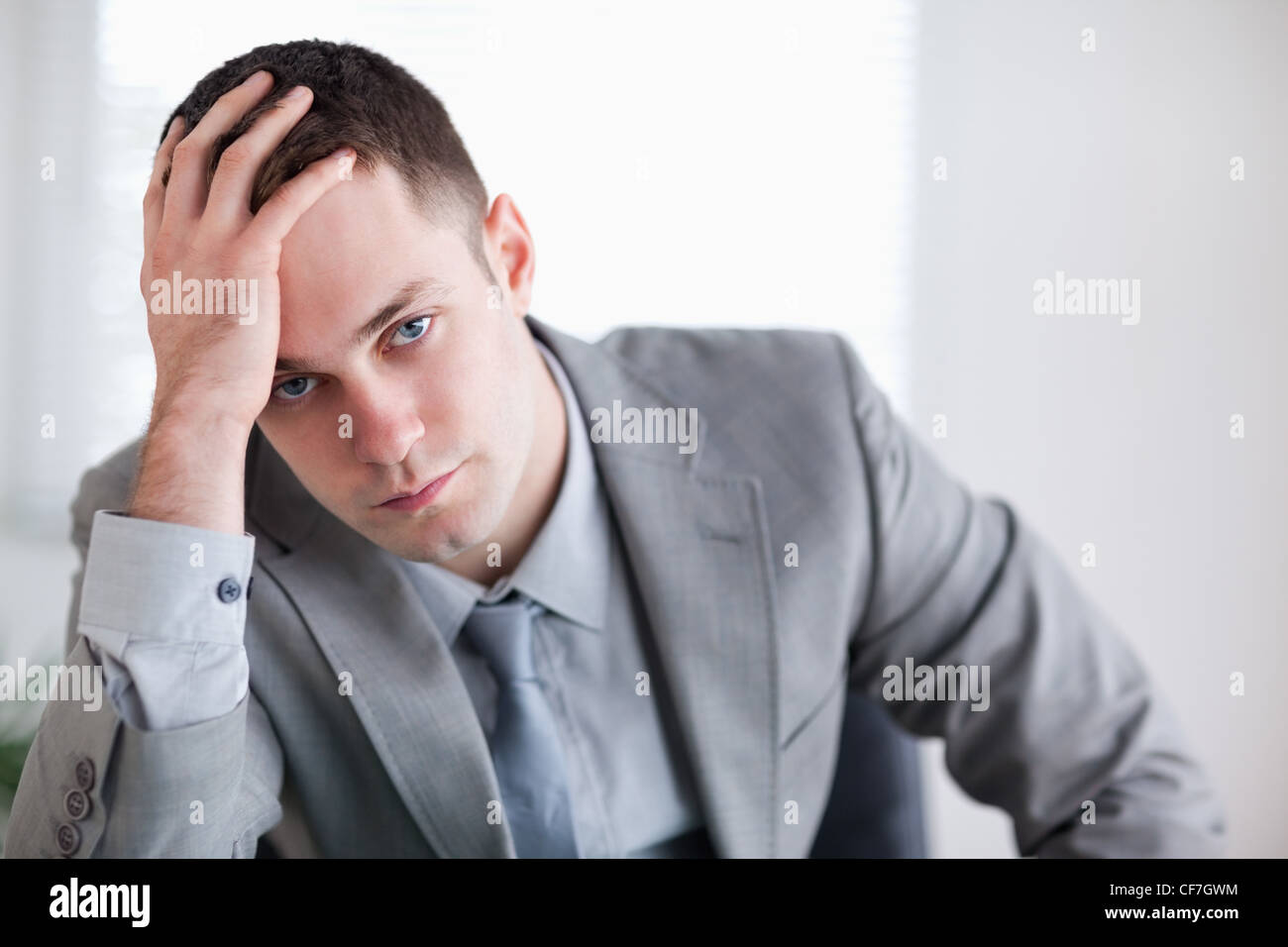 Close up of businessman who got bad news - Stock Image