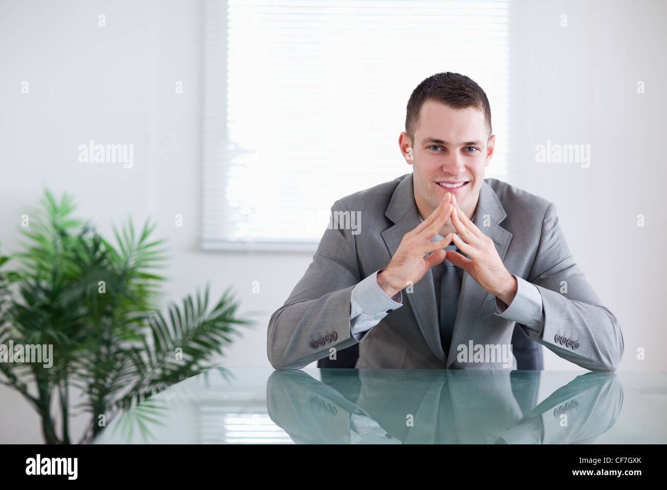 Young businessman getting good news - Stock Image