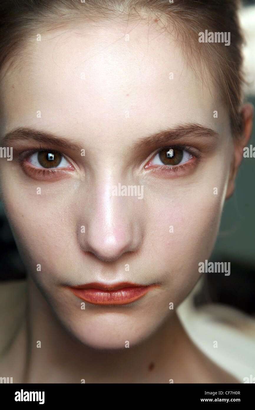 Richard Nicoll Backstage London Ready to Wear Autumn Winter Close up face of female wearing copper eyeshadow and - Stock Image