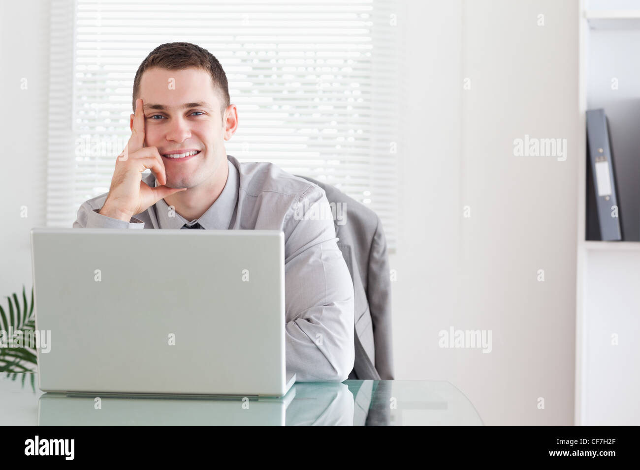 Businessman getting good news via email - Stock Image