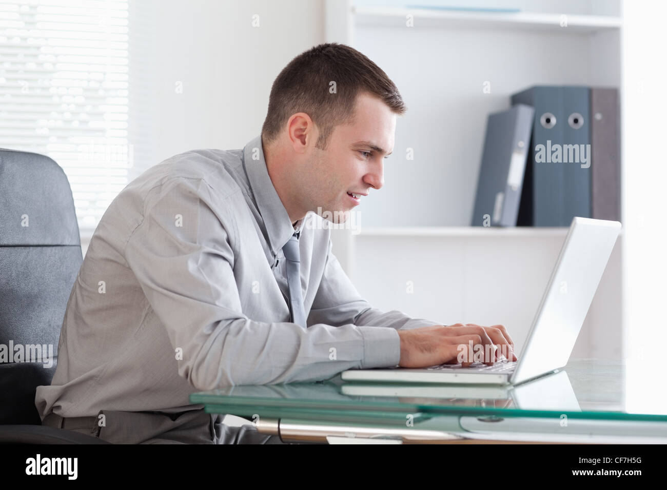Businessman working concentrated on his laptop - Stock Image