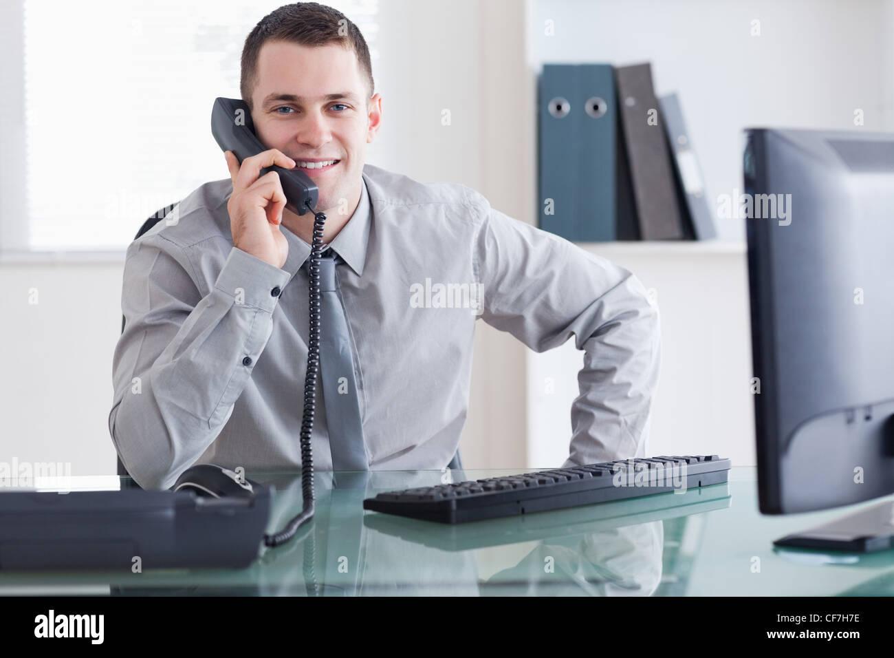 Businessman getting good news - Stock Image
