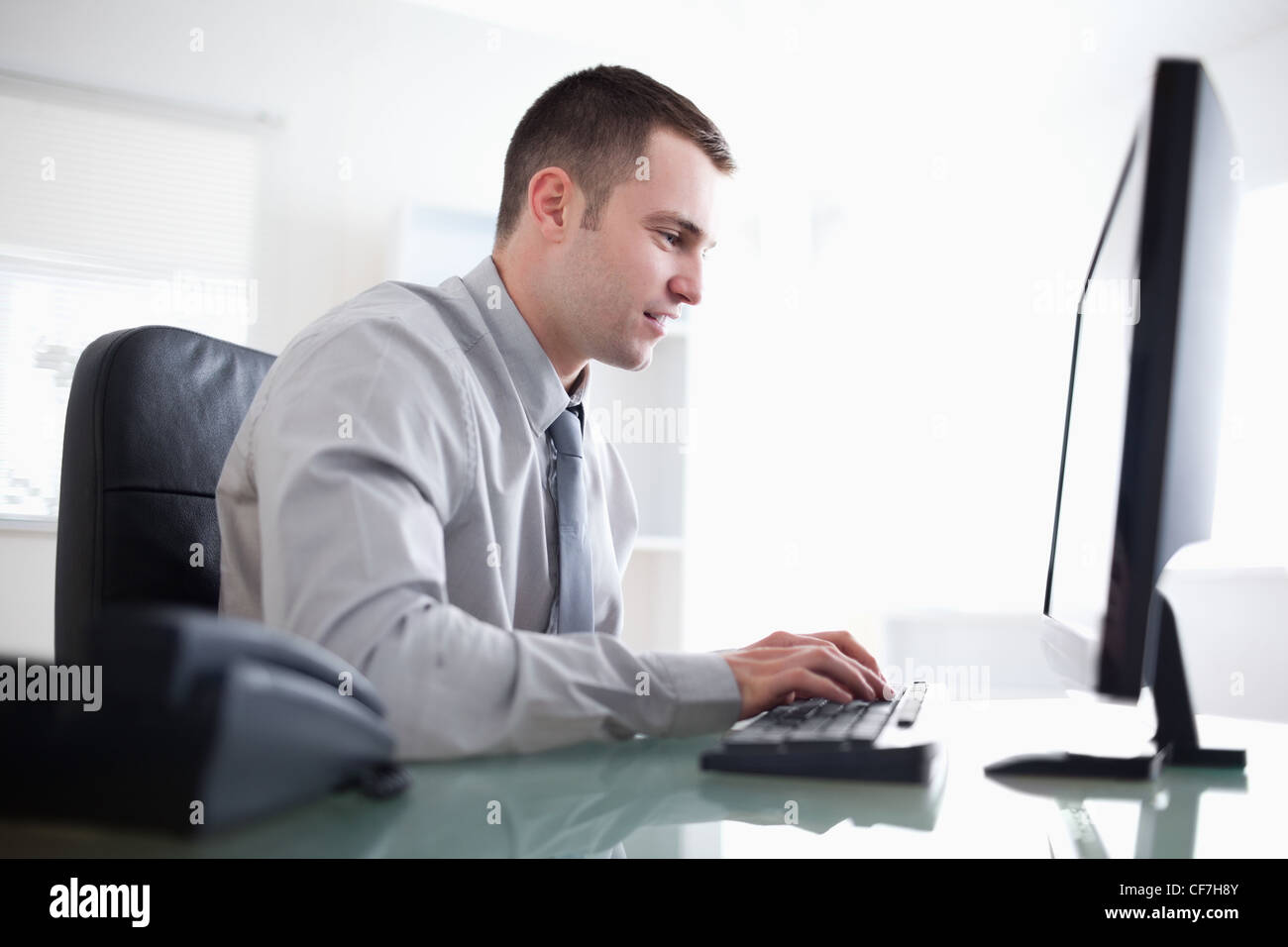 Businessman working concentrated on his computer - Stock Image