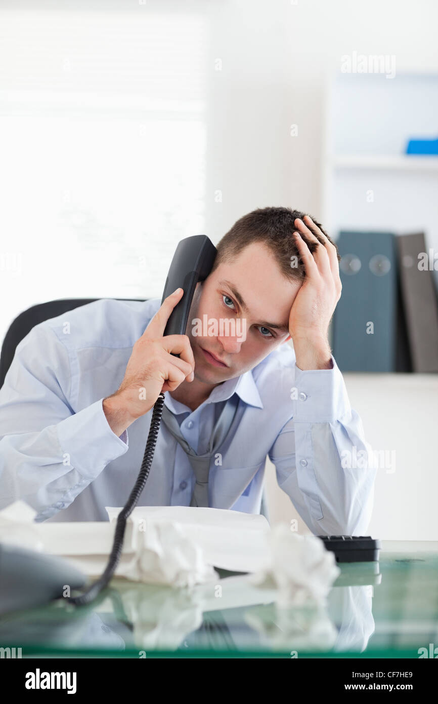 Close up of businessman trying to solve a problem on the phone - Stock Image