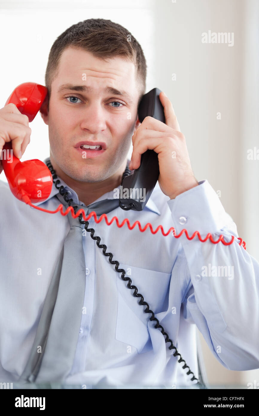 Close up of businessman troubled by the telephone - Stock Image