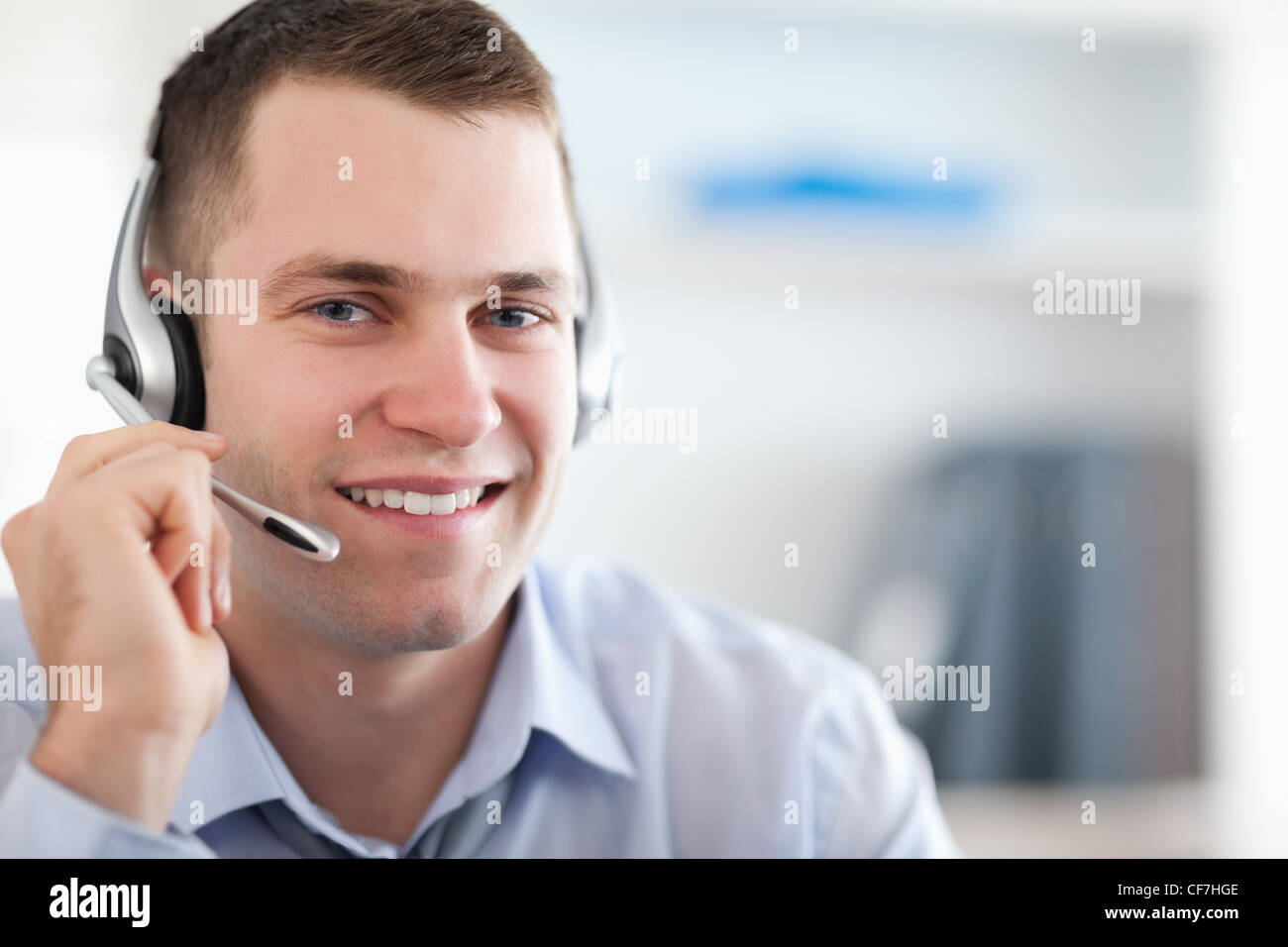 Close up of call center agent helping costumer - Stock Image