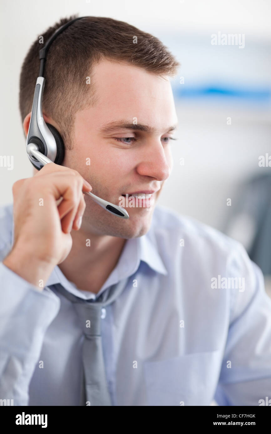 Close up of call center agent solving a costumers problem - Stock Image