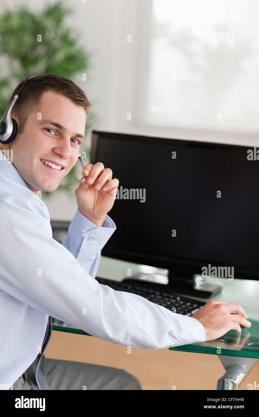 Shadowing a friendly call center agent - Stock Image